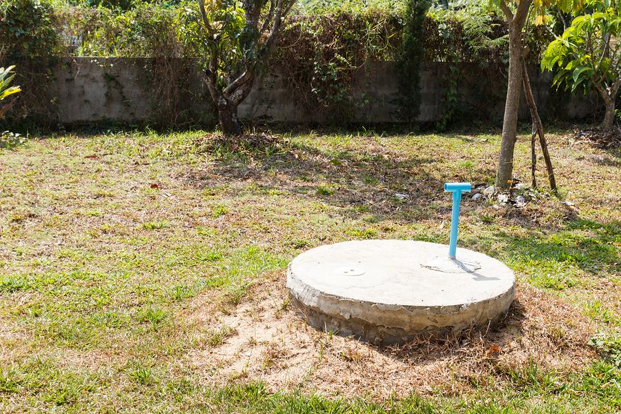 underground cement cylinder of lavatory cesspit in lawn yard