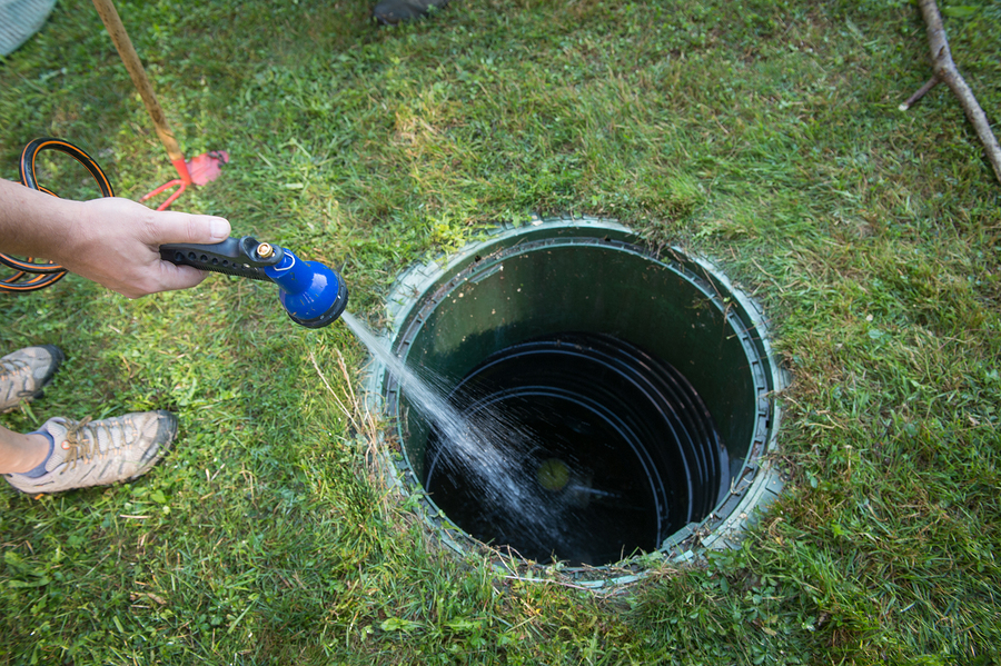 unrecognized person cleaning the septic tank